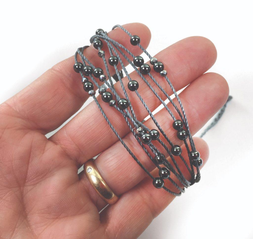 """Marion Hunziker-Larsen, """"Floating Beads Bracelet"""", Nylon Cord, Hematite & Crystal Beads, 2018 $19.00"""